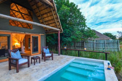 The swimming pool at or near Royal Zambezi Lodge