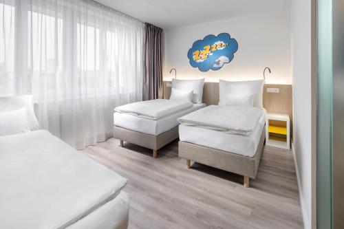 A bed or beds in a room at Comfort Hotel Prague City East