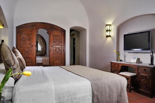 Ліжко або ліжка в номері Mövenpick Resort Sharm El Sheikh
