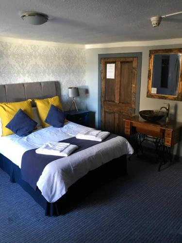 A bed or beds in a room at The Bruce Inn