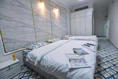 A bed or beds in a room at DreamWhite Hotel