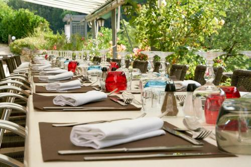 A restaurant or other place to eat at Logis Belle Rive