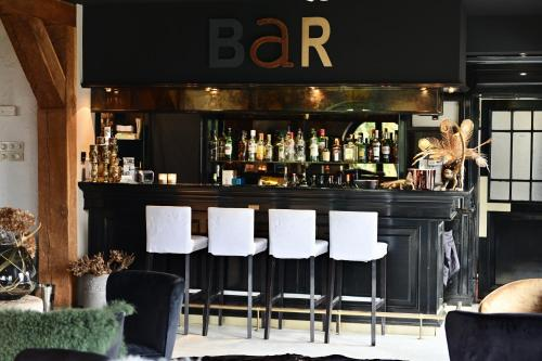 The lounge or bar area at Hotel Ten Lande