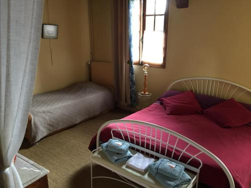 A bed or beds in a room at La Coraline