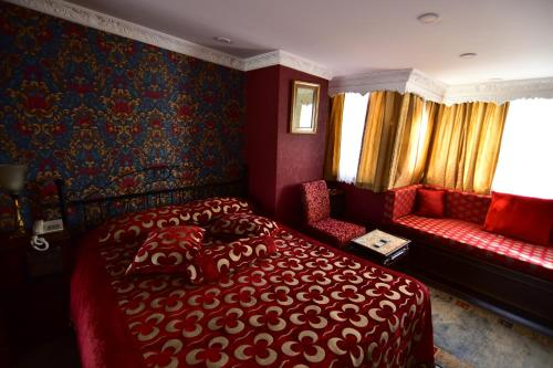 A bed or beds in a room at Kybele Hotel