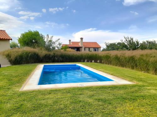 The swimming pool at or near Casa Prana by Cafayate Holiday