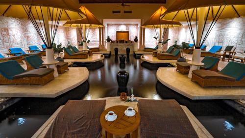 A restaurant or other place to eat at Nexus Resort & Spa Karambunai