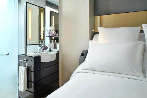 A bed or beds in a room at YOTEL Singapore Orchard Road (SG Clean, Staycation Approved)