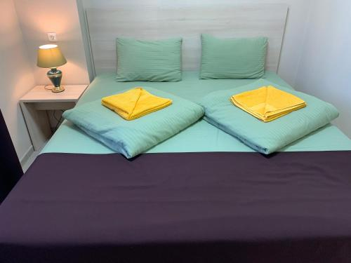 A bed or beds in a room at Hostel Miller