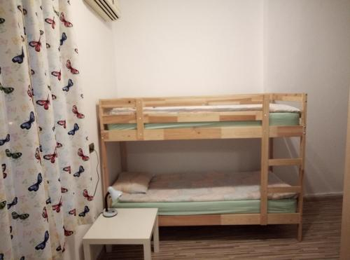 A bunk bed or bunk beds in a room at Casablanca City