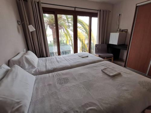 Cama o camas de una habitación en Hotel Gran Sol