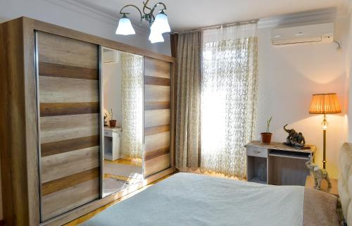 A bed or beds in a room at Apartment on Rustaveli Avenue