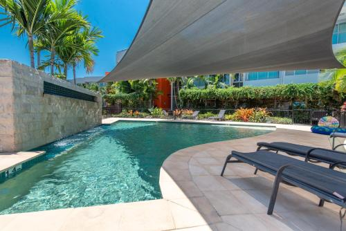 The swimming pool at or near Private Seaview Apartment at Peninsula - Airlie Beach