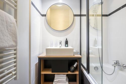 Ванная комната в Aparthotel Adagio La Défense Kléber