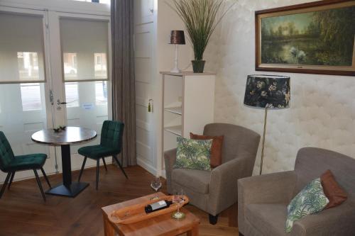 Гостиная зона в De Gouverneur appartement