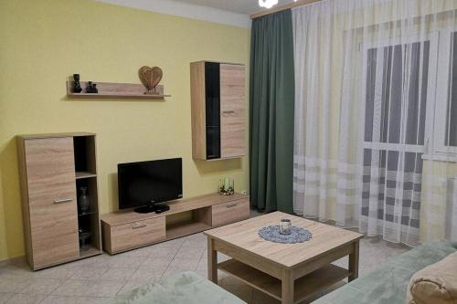 A television and/or entertainment center at APARTMAN 99