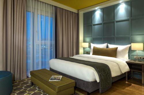 En eller flere senge i et værelse på Citadines City Centre Frankfurt