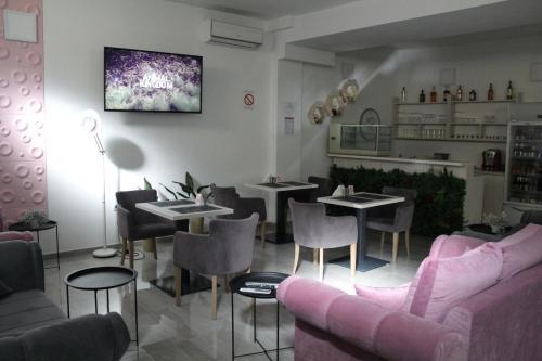 Restoran ili drugo mesto za obedovanje u objektu Garni Hotel 11tica DM