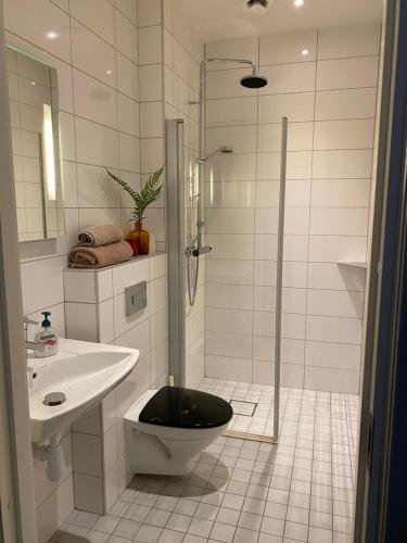 Ett badrum på Ting1903 Bed & Breakfast