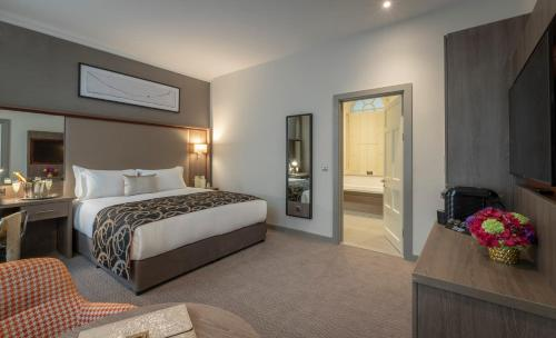 A bed or beds in a room at Clayton Hotel Charlemont