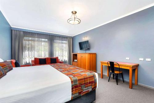 A bed or beds in a room at Quality Inn O'Connell