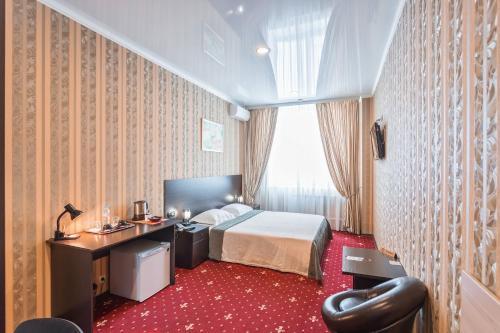 Кровать или кровати в номере Отель Шоколад