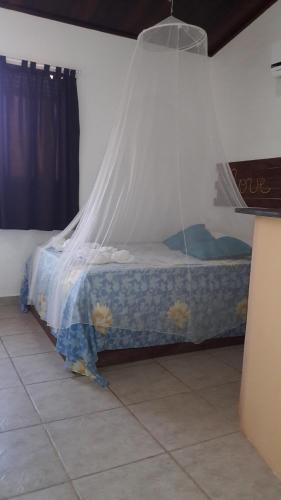Cama ou camas em um quarto em Pousada Samarkanda