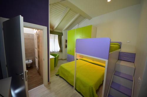 A bunk bed or bunk beds in a room at Family Hotel Primavera