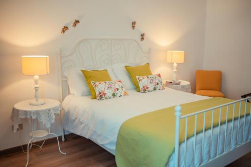 A bed or beds in a room at TaoApartments - Casa Vittoria