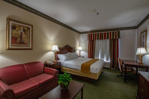 A bed or beds in a room at Moncks Corner Inn