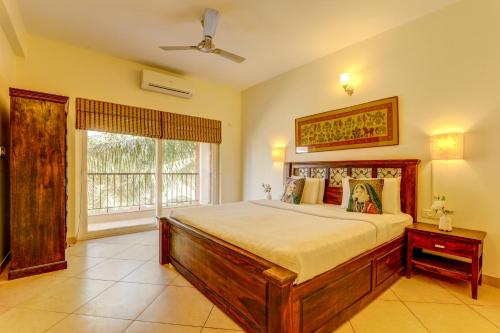 A bed or beds in a room at Heritage Nirvana Villa - 4 BHK, Baga
