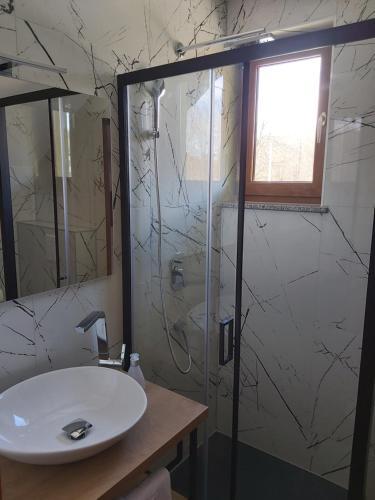 Koupelna v ubytování Pansion Villa Cancar
