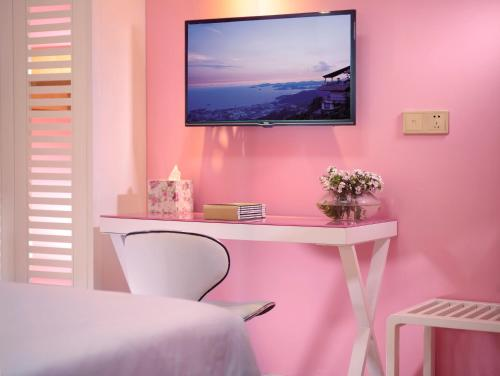 A television and/or entertainment center at Care Hotel Coast Collection