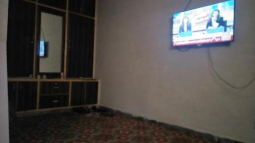 A television and/or entertainment center at Apna Guest House.