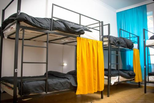 A bunk bed or bunk beds in a room at Paradise hostel