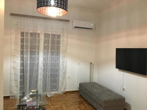A television and/or entertainment centre at Renovated apartment, 1' to metro st. Panormou