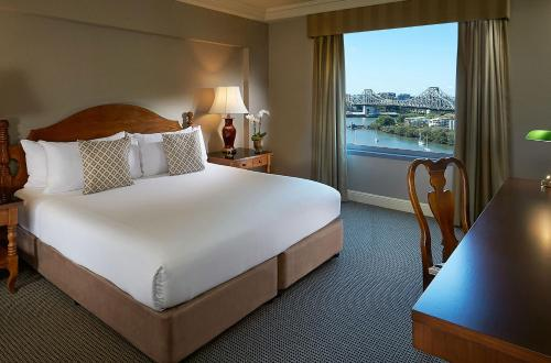 A bed or beds in a room at Stamford Plaza Brisbane