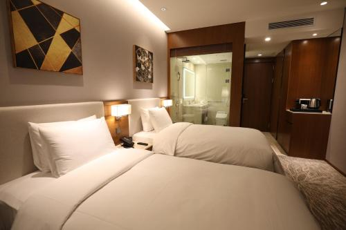 A bed or beds in a room at Somerset Central Bundang
