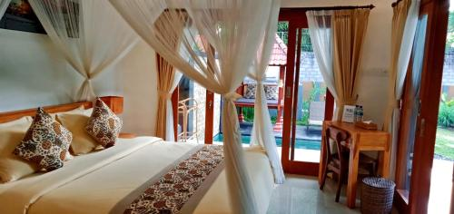 A bed or beds in a room at Kanaya Ubud