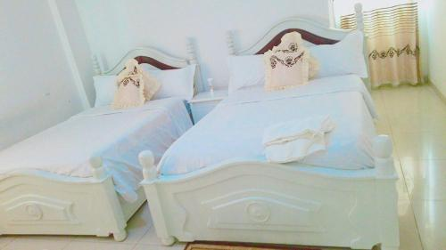 A bed or beds in a room at Winta Hotel