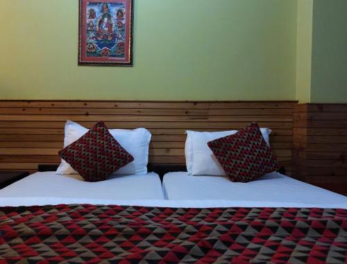 A bed or beds in a room at La Bougainvillea Retreat