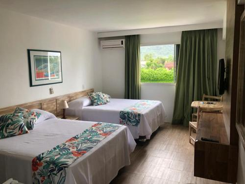 A bed or beds in a room at Wembley Inn Hotel