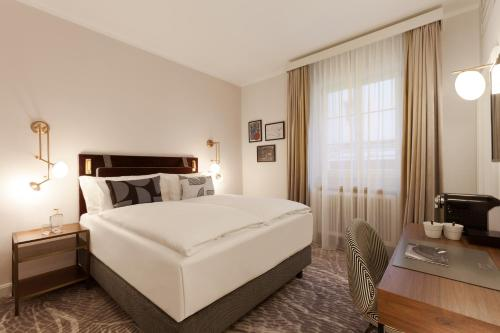 A bed or beds in a room at Hotel Elephant Weimar, Autograph Collection