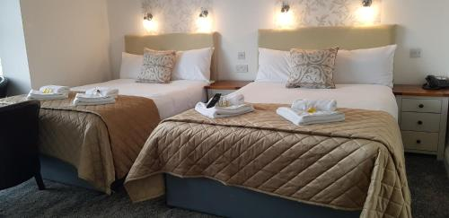 A bed or beds in a room at Atlantic Seafront