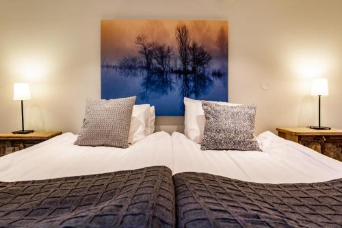 Ein Bett oder Betten in einem Zimmer der Unterkunft Hotell Breda Blick