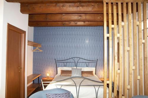Ein Bett oder Betten in einem Zimmer der Unterkunft Agriturismo Principe Pio