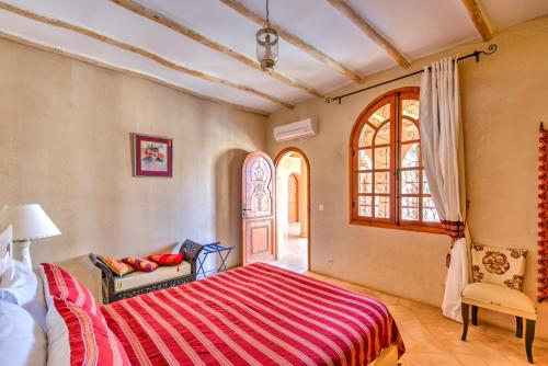 Un ou plusieurs lits dans un hébergement de l'établissement Riad Janoub