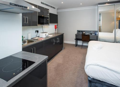 A kitchen or kitchenette at Best Western Chiswick Palace & Suites London