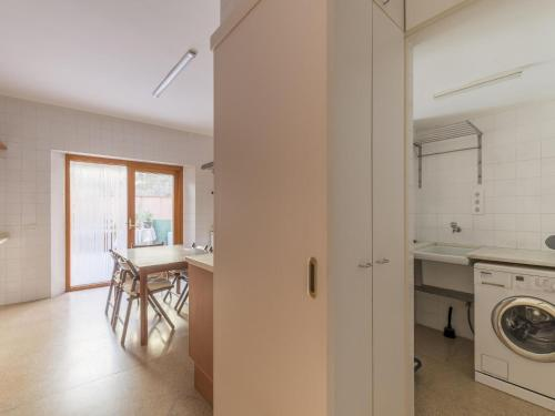 A kitchen or kitchenette at Elegant Holiday Home in Sant Boi de Llobregat with Terrace