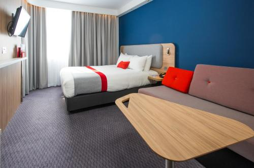 A bed or beds in a room at Holiday Inn Express Burton on Trent